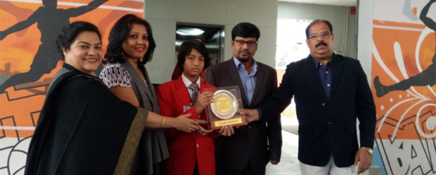 Literacy Award presented to a 10 year old prodigy author, poet and traveller for her first novel ' The Secret of the Goldbug Castle 'by principal Ms Anita George and director Mr J Mathew